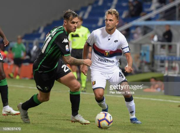 Pol Lirola of US Sassuolo competes for the ball with Domenico Criscito of Genoa CFC during the serie A match between US Sassuolo and Genoa CFC at...