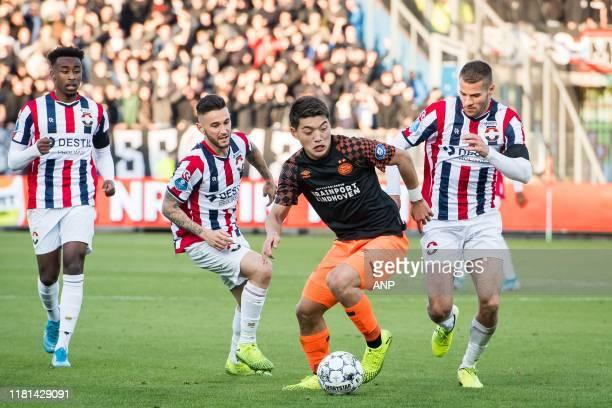 Pol Llonch of Willem II Ritsu Doan of PSV Bart Nieuwkoop of Willem II during the Dutch Eredivisie match between Willem II Tilburg and PSV Eindhoven...