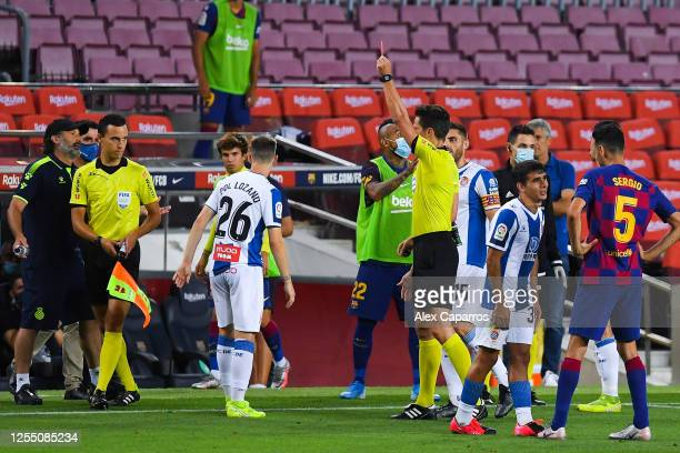 Pol Lozano of RCD Espanyol is shown a red car by the referee during the Liga match between FC Barcelona and RCD Espanyol at Camp Nou on July 08 2020...