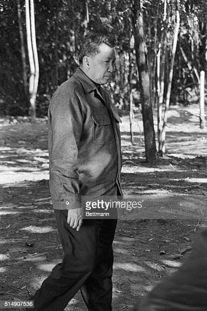 Pol Pot leader of the Khmer Rouge in the Cambodian jungle walking Filed