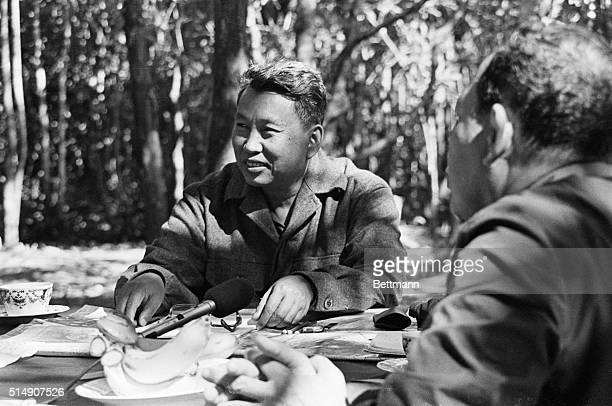 Pol Pot leader of the Khmer Rouge in the Cambodian jungle with an ABC news team during an interview Filed