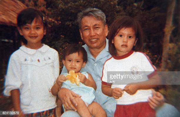 Pol Pot with children and daughter Saloth Sitha on his lap in 1988
