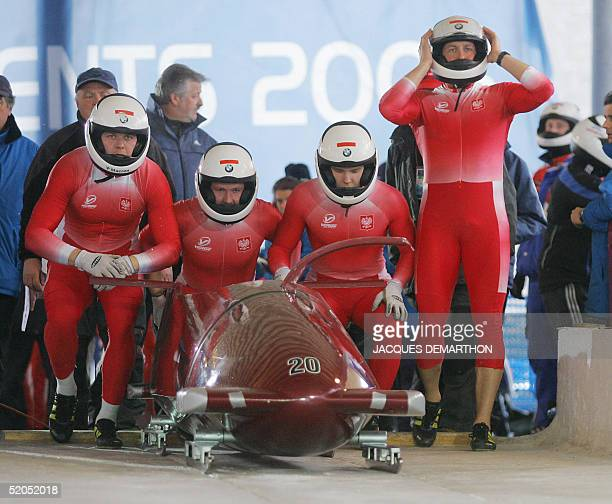 Poland 1 bobsleigh Michal Zblewski Mariusz Latkowski Ireneusz Zurawicz and Dawid Kupczyk concentrate before starting 23 January 2005 at Cesana Pariol...