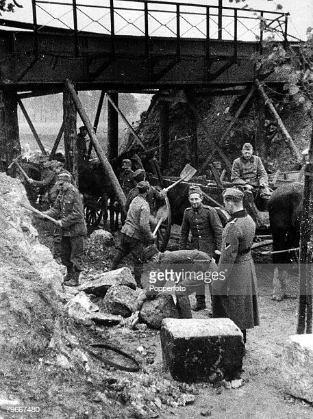 Poland 28th October Polish prisoners of war doing reconstruction work under the eye of a Nazi German officer in the former Polish province of Posen...