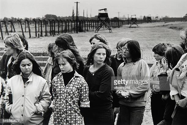 Poland Auschwitz German pupils visiting the concentration camp girls looking concerned
