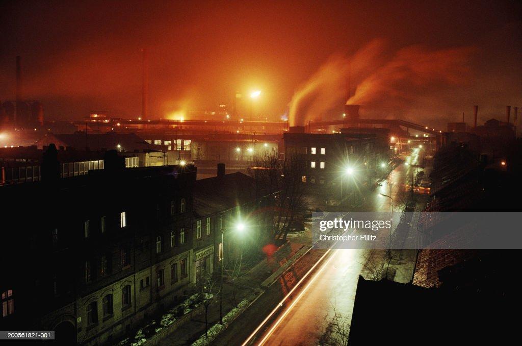 Poland, Bytom, Bobrek steelworks and residential housing, night : Stock Photo