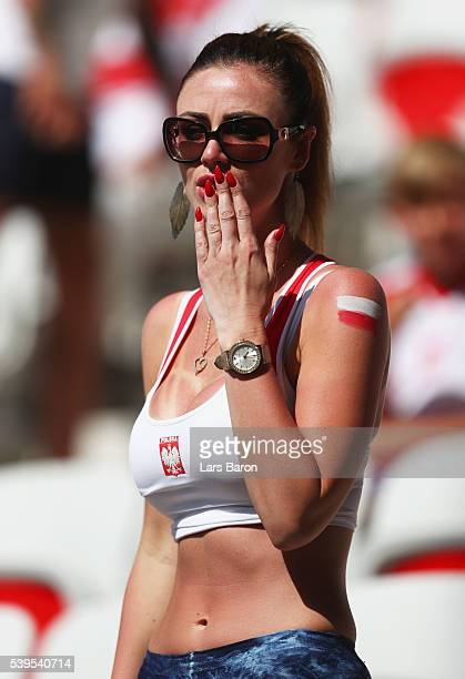Poland fan blows a kiss prior to the UEFA EURO 2016 Group C match between Poland and Northern Ireland at Allianz Riviera Stadium on June 12 2016 in...