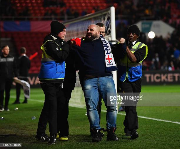 Poland fans is taken by security during the U21 International Friendly match between England and Poland at Ashton Gate on March 21 2019 in Bristol...