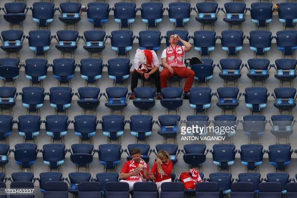 Poland fans look dejected after the UEFA EURO 2020 Group E football match between Poland and Slovakia at the Saint Petersburg Stadium in Saint...
