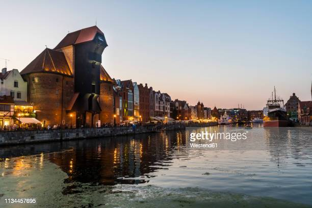 poland, gdansk, hanseatic league houses and crane house on the motlawa river at dusk - motlawa river stock pictures, royalty-free photos & images