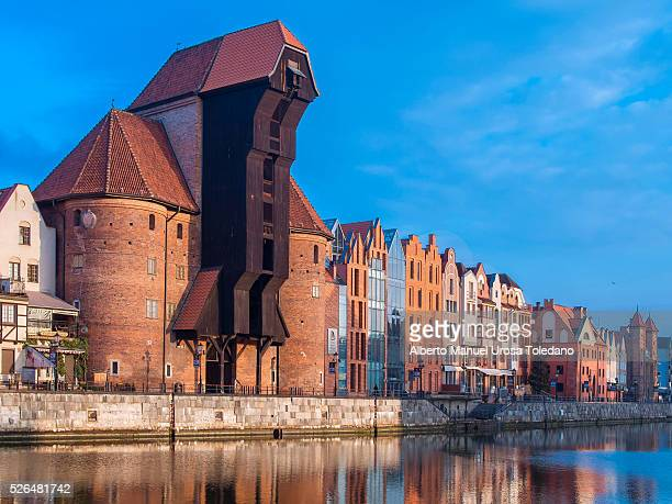 poland, gdansk, motlawa river and zuraw crane sunset - gdansk stock pictures, royalty-free photos & images
