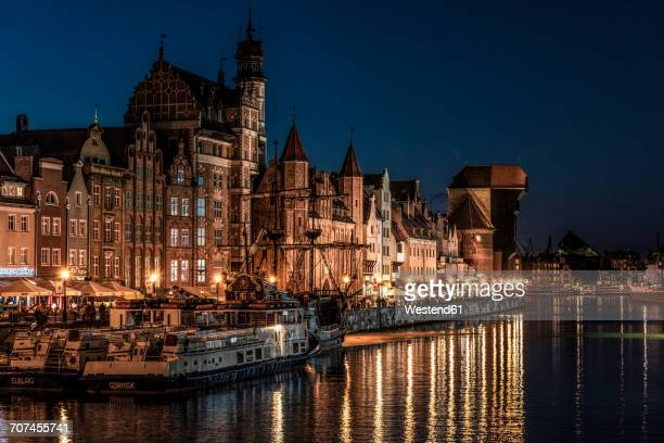 Poland, Gdansk, old town, Motlawa river with The Crane and St. Marys Gate at night