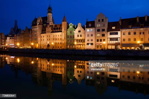 poland, gdansk, skyline at motlawa bank with river reflection - motlawa river stock pictures, royalty-free photos & images
