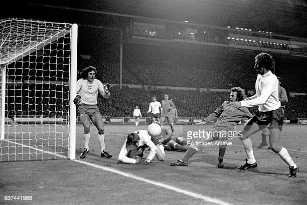 Poland goalkeeper Jan Tomaszewski covers his near post as England's Allan Clarke and Martin Chivers try to force the ball in