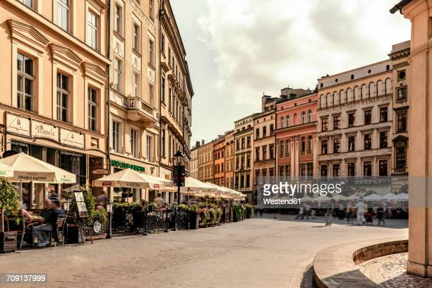 poland, krakow, old town, town houses at main square - pavement cafe stock pictures, royalty-free photos & images