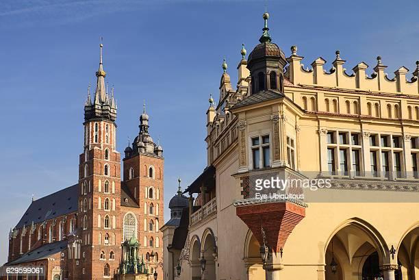 Poland Krakow Rynek Glowny or Main Market Square A corner of the Cloth Hall with St Marys Church also known as St Marys Basilica
