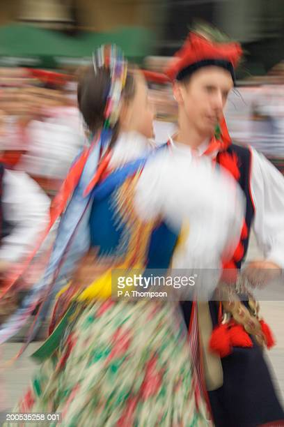 Poland, Krakow, traditional dancers, (blurred motion)