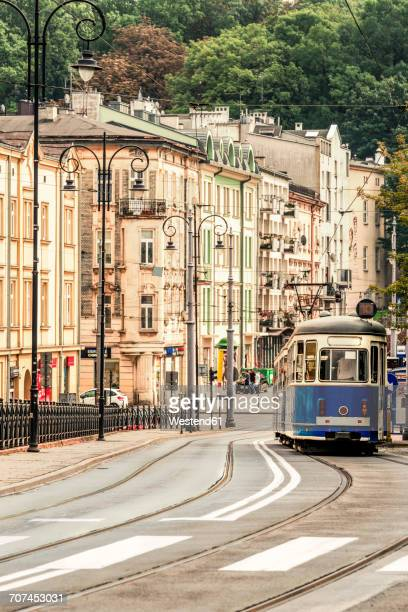 poland, krakow, tram in the old town - krakow stock pictures, royalty-free photos & images