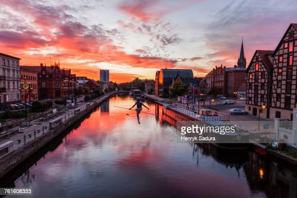 poland, kuyavian-pomeranian, bydgoszcz, brda river, dramatic sky reflecting in water surface - bydgoszcz stock pictures, royalty-free photos & images