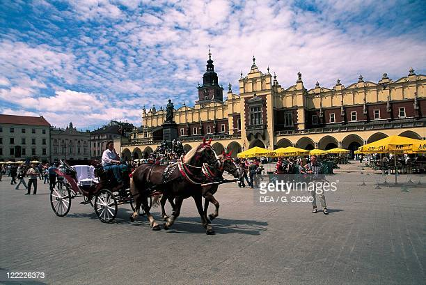 Poland Malopolskie voivodship Krakow Historic Centre Main Market Square Horsedrawn carriage