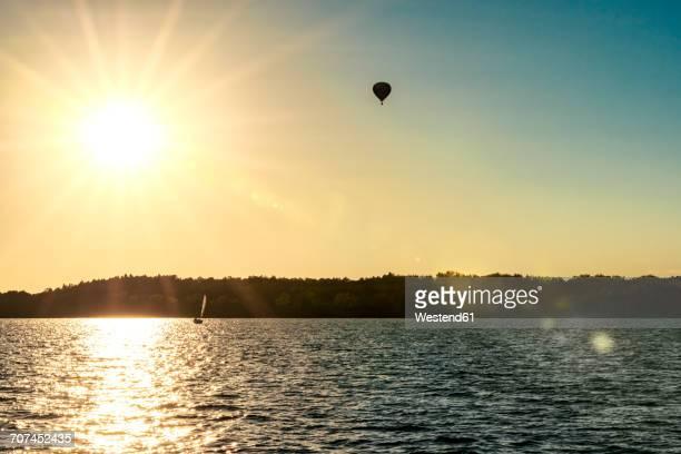 Poland, Masuria, Captive baloon over Lake Niegocin