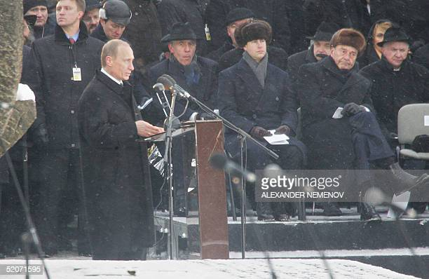 Russian President Vladimir Putin holds a speech as Prince Edward Earl of Wessex and French President Jacques Chirac listen 27 January 2005 at the...