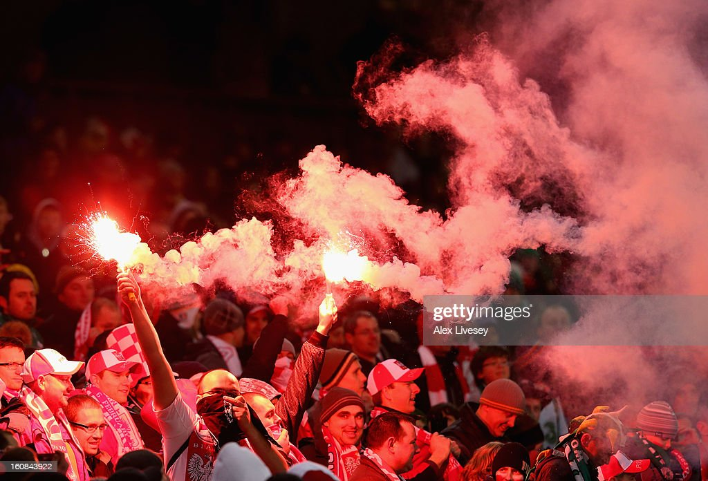 Poland supporters let off flares during the International Friendly match between Republic of Ireland and Poland at Aviva Stadium on February 6, 2013 in Dublin, Ireland.