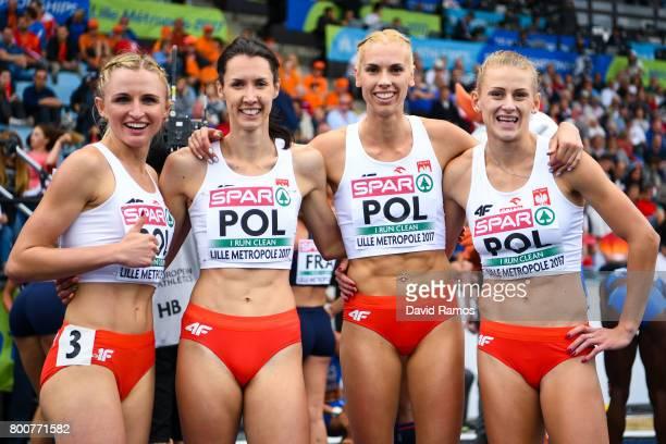 Poland team members Iga Baugmart Patrycja Wyciszkiewicaz Martyna Dabrowska and Malgorzata Holub pose after winning the Women's 4x400m Relay Final...