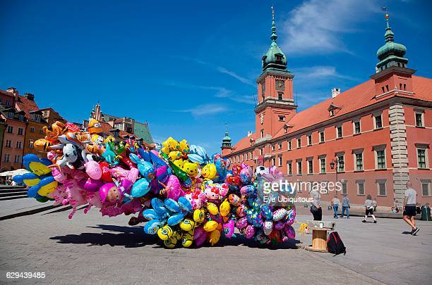 Poland Warsaw Old Town Plac Zamkowy Arkady Kubickiego Red Brick Royal Castle with balloon vendor in the foreground