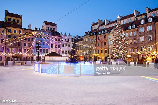 poland, warsaw, old town square with ice rink during christmas time in the evening - ice rink stock pictures, royalty-free photos & images