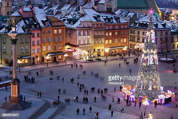 Poland, Warsaw, view to Castle Square with Sigismunds Column and lighted Christmas tree by night