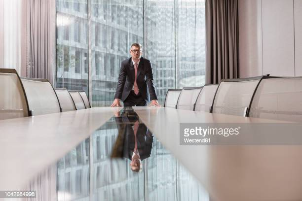 poland, warzawa, businessman standing at conference table in hotel - formal businesswear stock pictures, royalty-free photos & images