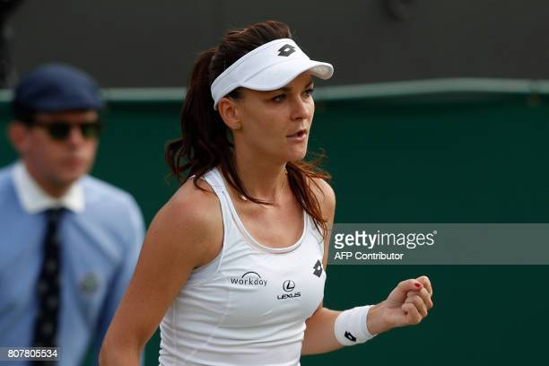 Poland's Agnieszka Radwanska celebrates beating Serbia's Jelena Jankovic during their women's singles first round match on the second day of the 2017...