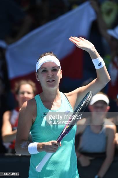 Poland's Agnieszka Radwanska celebrates her victory against Ukraine's Lesia Tsurenko during their women's singles second round match on day four of...