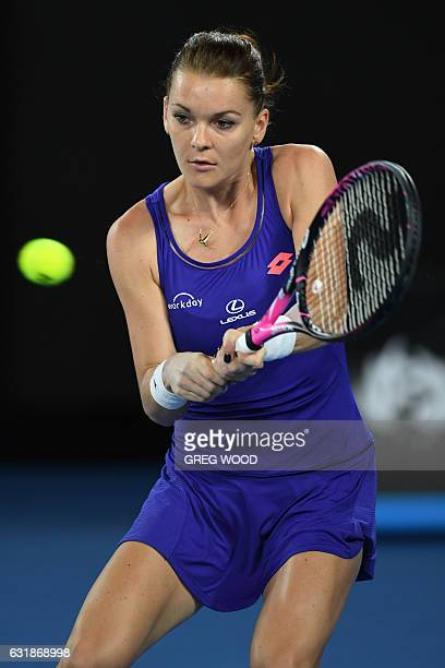 Poland's Agnieszka Radwanska hits a return against Bulgaria's Tsvetana Pironkova during their women's singles match on day two of the Australian Open...
