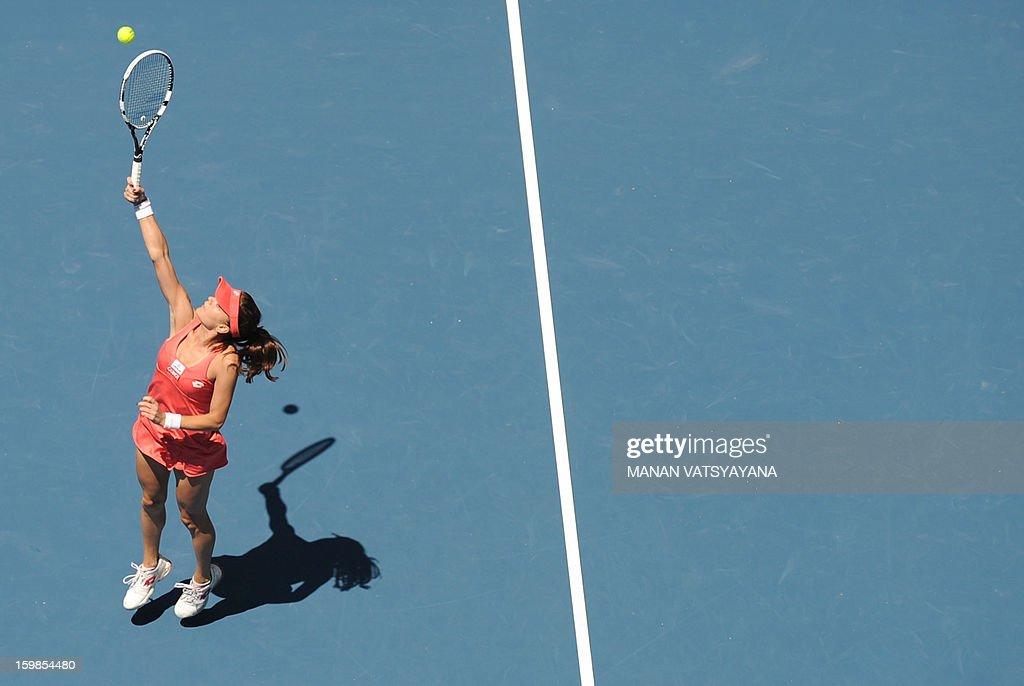 Poland's Agnieszka Radwanska hits a return against China's Li Na during their women's singles match on day nine of the Australian Open tennis tournament in Melbourne on January 22, 2013.