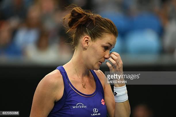 Poland's Agnieszka Radwanska reacts while playing against Croatia's Mirjana LucicBaroni during their women's singles second round match on day four...