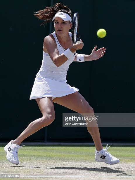 Poland's Agnieszka Radwanska returns against Russia's Svetlana Kuznetsova during their women's singles fourth round match on the seventh day of the...