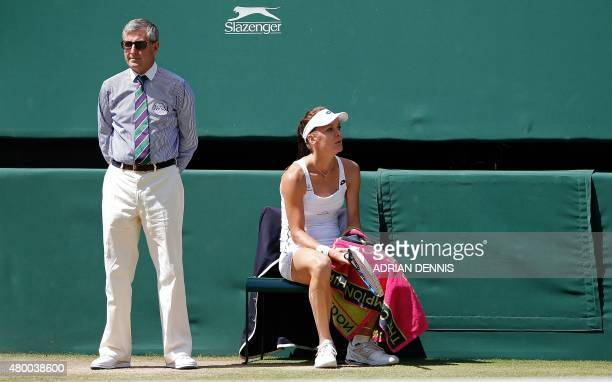 Poland's Agnieszka Radwanska sits down on the line judge's chair after breaking the serve of Spain's Garbine Muguruza during their women's semifinal...