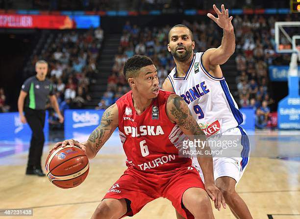 Poland's AJ Slaughter vies with France's Tony Parker during the group A qualification basketball match between France and Poland at the EuroBasket...