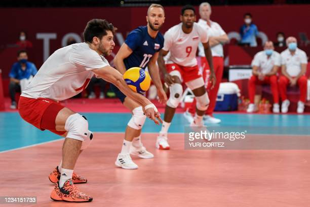 Poland's Aleksander Sliwka sets the ball in the men's preliminary round pool A volleyball match between Poland and Iran during the Tokyo 2020 Olympic...