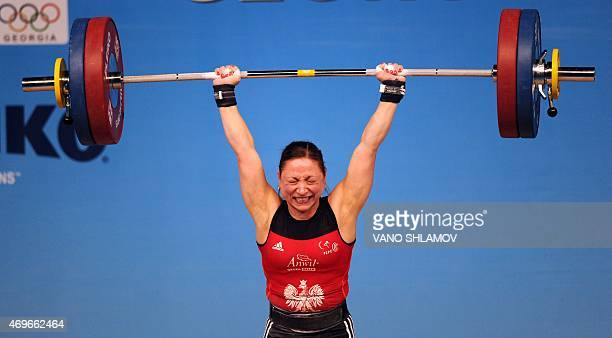 Poland's Aleksandra Klejnowska competes in the women's 58A kg category at the European Weightlifting Championships in Tbilisi on April 13, 2015. AFP...