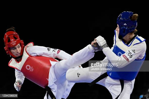 Poland's Aleksandra Kowalczuk and Britain's Bianca Walkden compete in the taekwondo women's +67kg bronze medal B bout during the Tokyo 2020 Olympic...
