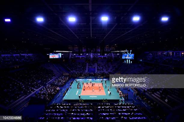 TOPSHOT Poland's and Serbia's teams play during the men's volleyball match between Poland and Serbia during the FIVB Men's World Championships 2018...