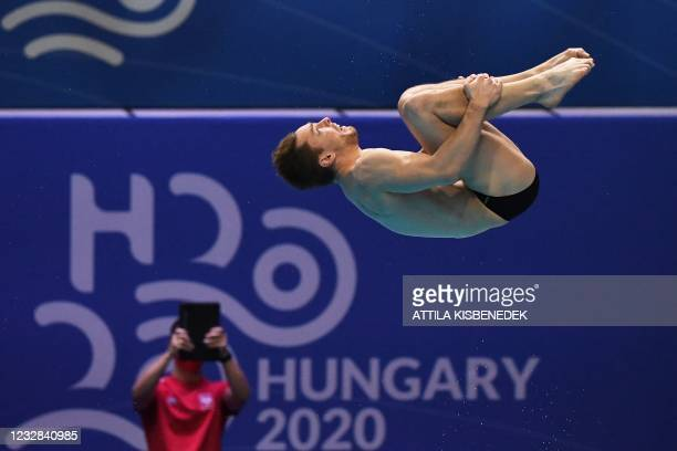 Poland's Andrzej Rzeszutek competes in the preliminary for the Men's 1m Springboard Diving event during the LEN European Aquatics Championships at...