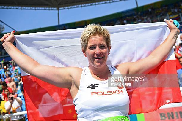 Poland's Anita Wlodarczyk celebrates after winning the gold medal and breaking a world record in the Women's Hammer Throw Final during the athletics...