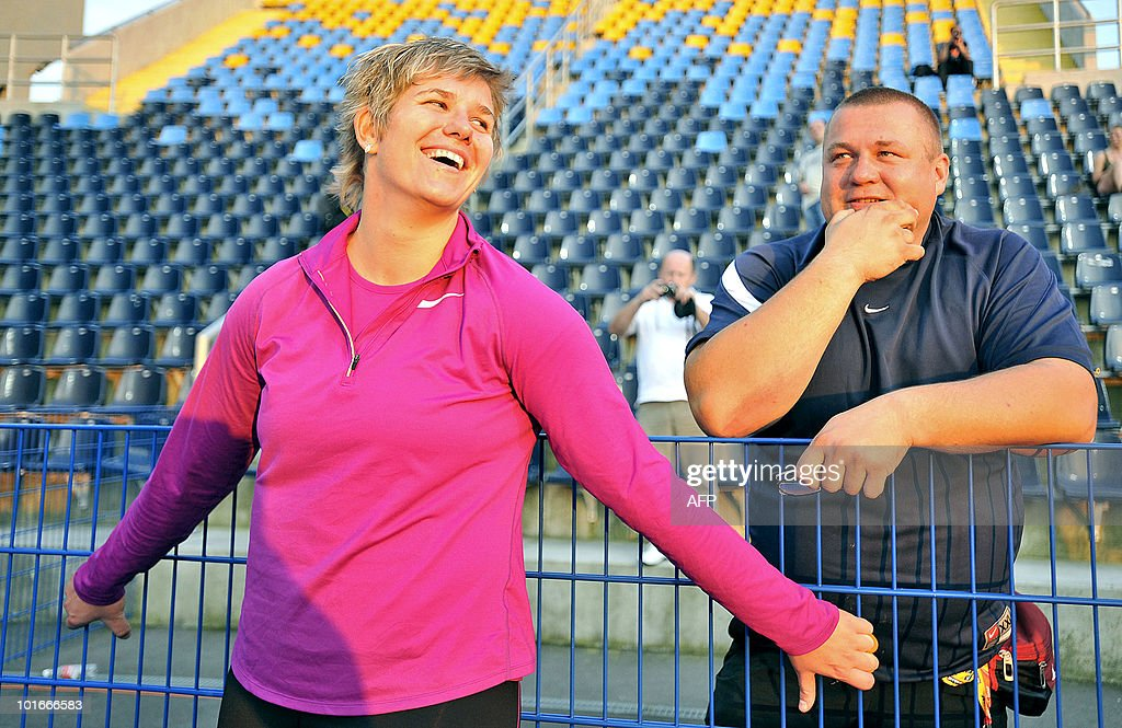 Poland's Anita Wlodarczyk (L) laughs with her coach Krzysztof Kaliszewski between two attempts in the women's hammer throw event on June 6, 2010 during the 10th European Athletics Festival ENEA Cup in Bydgoszcz. Wlodarczyk set a new world record of 78.30m.