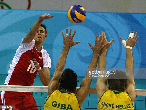Poland's Anna Wozniakowska slams a shot against Brazil during their preliminary volleyball match of the 2008 Beijing Olympic Games om August 16 2008...