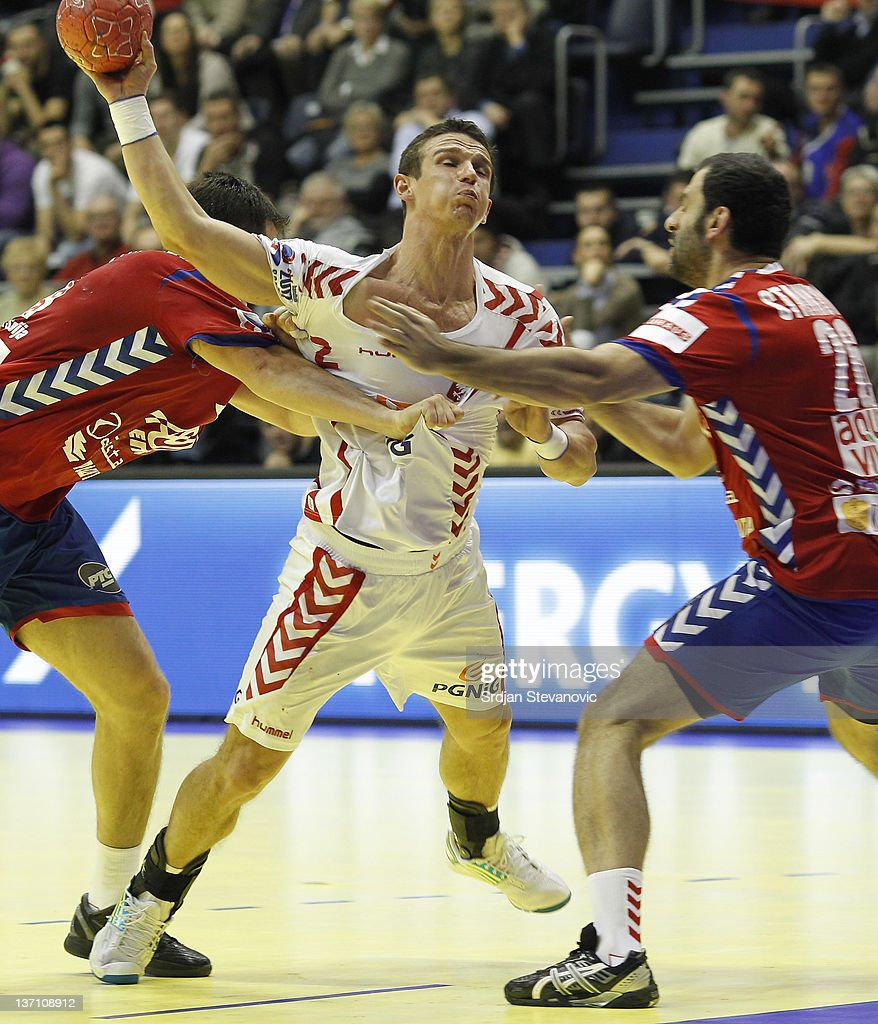 Poland's Bartlomiej Jaszka in action against Serbia's Marko Vujin (L) and Ivan Stankovic ¨, during the Men's European Handball Championship group A match between Poland and Serbia at Pionir Sports Centre on January 15, 2011 in Belgrade, Serbia.