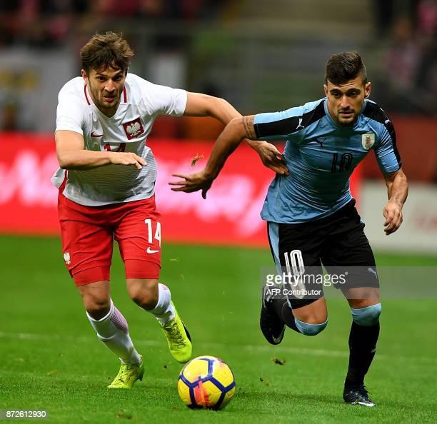 Poland's Bartosz Bereszynski and Uruguay's Giorgian de Arrascaeta vie for the ball during their international friendly football match between Poland...